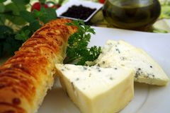 French breakfast. French cheese and bread with cheese, wine, some herbs, nuts and pepper Royalty Free Stock Images