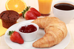 French Breakfast. With a croissant and strawberry jam. Served with coffee, orange juice and a muffin Royalty Free Stock Photography
