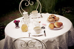 French breakfast. A French breakfast table with croissants and tea Stock Image