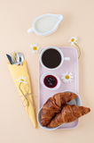 French breakfast: black coffee, milk and a croissant with jam se Stock Photography