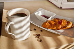 French breakfast - coffee, croissant and jam. French breakfast - coffee, croisant and jam on kitchen table Royalty Free Stock Photo