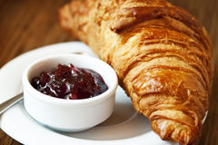 French Breakfast with Corissant and Berry Jam. French Breakfast with Croissant and Berry Jam,Delicious Breakfast Stock Photos