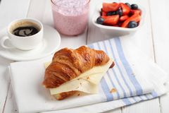 Simple breakfast with  croissant and cheese, dessert with raspberries. Simple breakfast with  croissant and cheese, desser with raspberries. Yogurt and coffee royalty free stock image