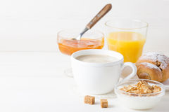 French Breakfast. With croissants, apricot jam, coffee, orange juice and natural yogurt with cornflakes served on white wooden table Royalty Free Stock Images