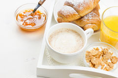 French Breakfast. With croissants, apricot jam, coffee, orange juice and natural yogurt with cornflakes served on white wooden table Stock Photography