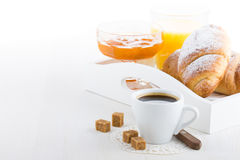French Breakfast. With croissants, apricot jam, coffee and orange juice served on white wooden table Stock Image