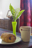 French breakfast with  lily of the valley Stock Photography