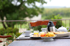 French breakfast placed on table of garden. Traditional french breakfast in charming hotel Royalty Free Stock Photos