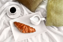 French breakfast served to bed. Coffee, croissant and milk, top view Royalty Free Stock Image