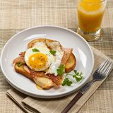 French breakfast toast with fried eggs Stock Image