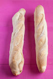 French Bred Baguette. Two aligned french bred called baguette on a purple background Stock Photo