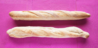 French Bred Baguette. Two aligned french bred called baguette on a purple background stock photography