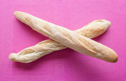 French Bred Baguette. Two crossed french bred called baguette on a purple background royalty free stock photo