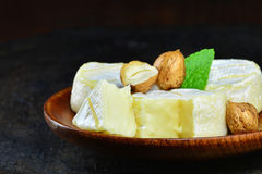 French brie cheese wheels with hazelnuts Stock Images