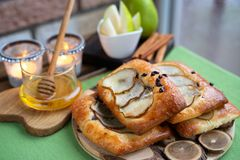 French brioche bun with pear, honey and tea on wooden table.  stock photo