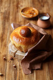 French Brioche Bun. On wooden board, on wooden background royalty free stock photo