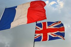 French and British Flags. Wave in the wind Royalty Free Stock Photography
