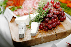 French Buffet with Salami Grapes and Cheese Royalty Free Stock Photo