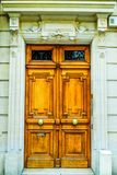 French building entrance beautiful wood door in Paris. French classic wooden building entrance beautiful wood door in Paris Royalty Free Stock Photography