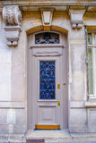 French building entrance beautiful wood door in Paris. French classic wooden building entrance beautiful wood door in Paris Royalty Free Stock Image