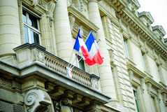 French building entrance beautiful wood door in Paris with the flag of France. In a national building Royalty Free Stock Photography