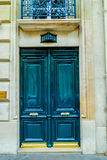 French building entrance beautiful wood door in Paris. Beautiful flowers flowers at a parisian garden during summer time in a flowers store in Paris Royalty Free Stock Image