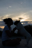 French bulldog kiss girl. French bulldog is cute kissing girl. She carry on a dog Royalty Free Stock Images