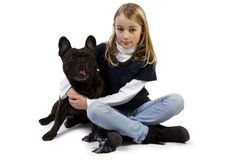 French bulldog and little girl playing Stock Photo