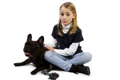 French bulldog and little girl playing Stock Image