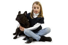 French bulldog and little girl playing Stock Images
