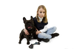 French bulldog and little girl playing Stock Photos