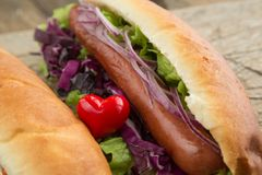 French bun hotdog with sausage and onion chips stock image