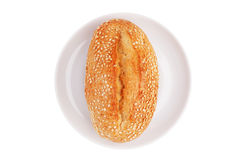 French bun with sesame seeds on a porcelain dish Stock Photos