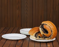 French buns with poppy seeds on saucer plate. Royalty Free Stock Photo