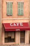 French cafe. Image of a cafe sign and awning at an old rural french house. Taken in Paris, France Royalty Free Stock Image