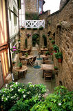 French Cafe. A secluded patio cafe in the Mt. St. Michel Stock Photo