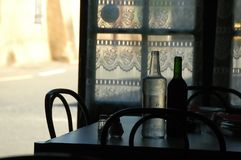 French Cafe. Wine and water on a French country resturant table royalty free stock photos