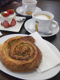French Cafe Pastries. French pastries and cafe au lait at a cafe in France Stock Images