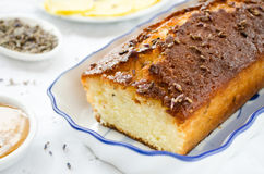 French cake with lavender flowers and lemon glaze Stock Image