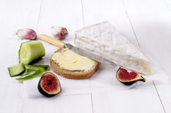 French camembert and slice bread with butter Royalty Free Stock Photos