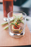 French canape in glass. On table with red beverage Royalty Free Stock Images