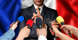 French candidate speaks to reporters - journalism concept Stock Photo