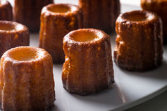 French Canele Cakes. Canele or cannele cakes are small French pastries with a custard center and caramelized crust stock images