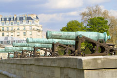 French cannon. Several long cannons aligned in the courtyard of the Invalides at Paris Royalty Free Stock Image