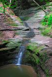 French Canyon. At the exit of French Canyon, a stream of water gently falls into a waiting pond Royalty Free Stock Images