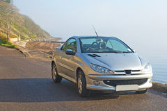 French car by the sea. Royalty Free Stock Photo