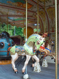 French carousel. With horses in the park Stock Image