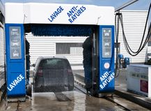 French carwash in action. With a black little car stock images