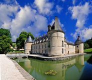 French Castle. French Chateau of Bussy Rabutin in Burgundy France from the rear showing the moat and dramatic sky Stock Photo