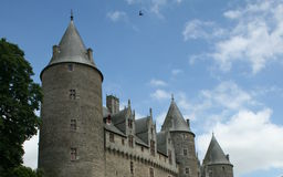 French Castle with Turrets - Brittany, France. Spectacular French castle bounded by  towers and turrets and framed by an azur mid summer french sky Royalty Free Stock Photos